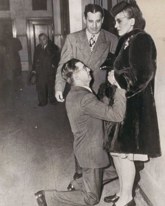 A man begs for his wife's forgiveness inside a Divorce Court, Chicago, 1948.