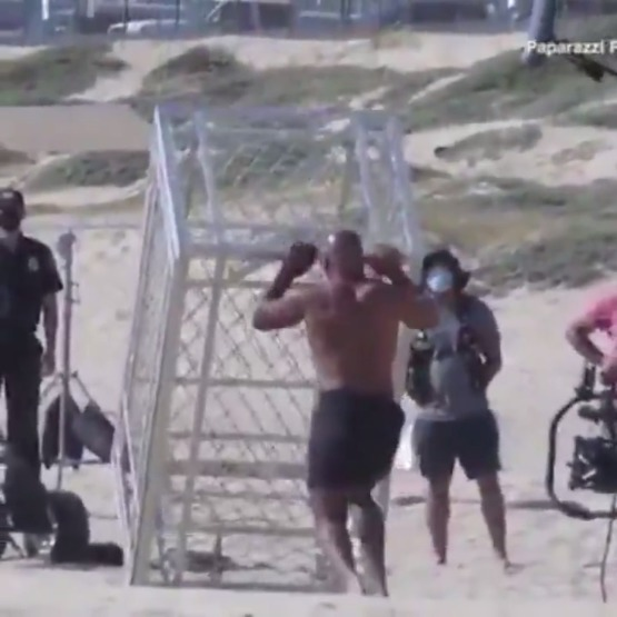 Mike Tyson tossing around a steel cage like it's nothing   (via )