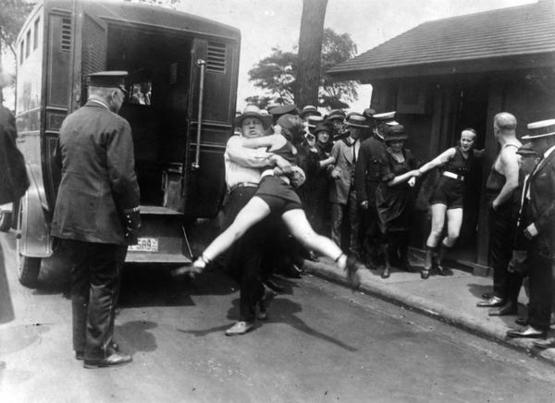 Woman being arrested for wearing one piece bathing suit, 1922, Chicago