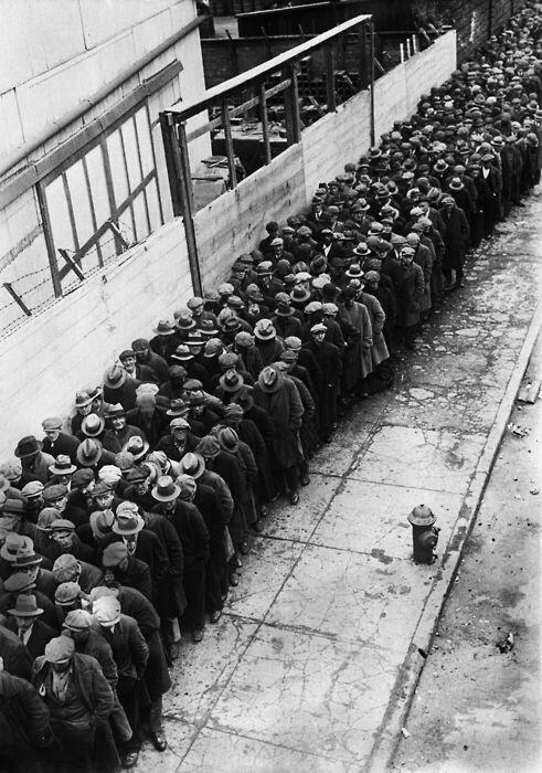 Men waiting in line for an opportunity at a job during the Great Depression, 1930