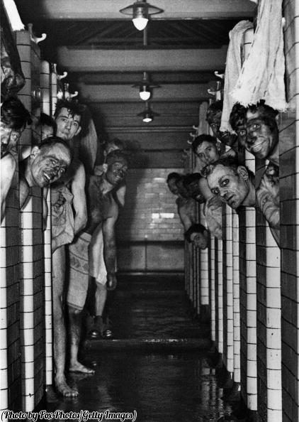 Miners taking a shower following a shift in the coal pit, 1940.