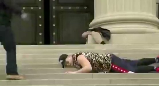 Protestors are seen recreating the George Floyd death at the National Capitol City Church