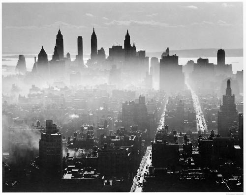 The Downtown Manhattan skyline rises from the morning fog, 1941 (by Andreas Feininger)