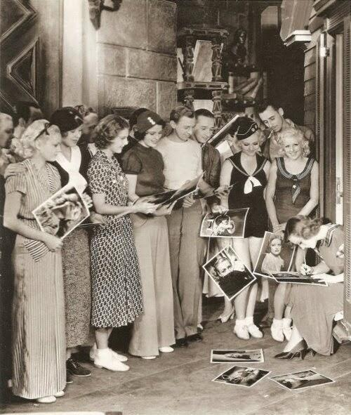 Joan Crawford signs autographs, c. 1930s