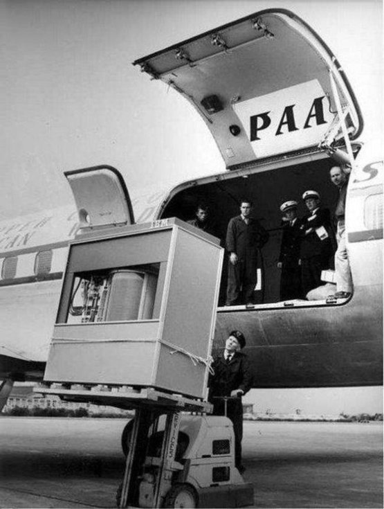A 5MB hard drive being loaded onto a PanAm plane, 1956.