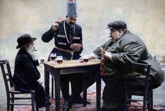 The shortest, tallest, and fattest man in Europe playing cards together in 1913.