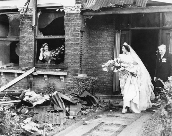 Bride leaving her recently bombed home to get married, London, Nov 4, 1940