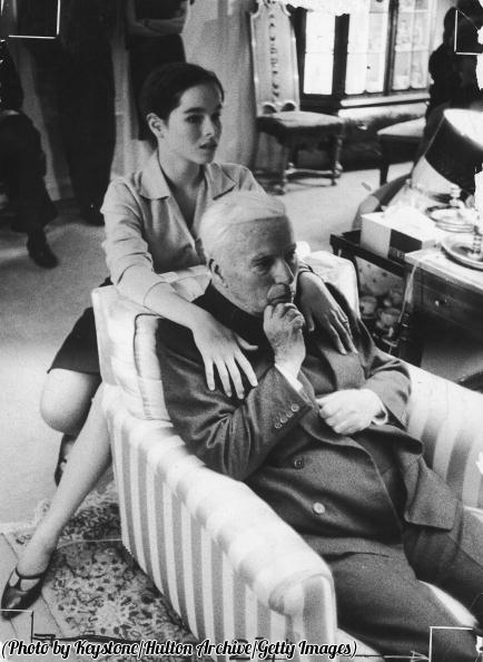 Charlie Chaplin with his daughter Geraldine on his 70th birthday, 1959.