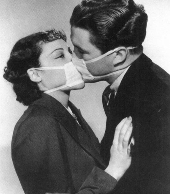 Couple kissing with surgical masks to prevent infection during a flu epidemic, 1937.