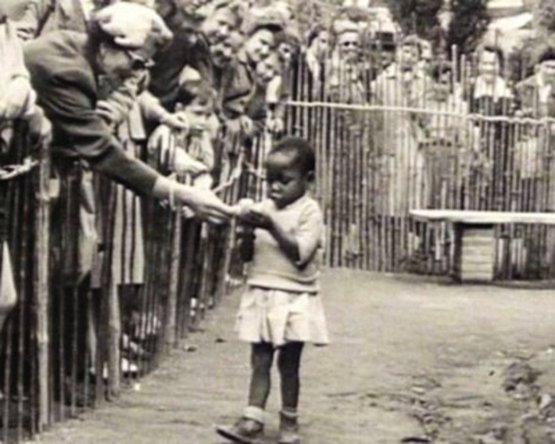 Human zoo. African girl in a Congolese village display at the Brussels 1958 World's Fair.