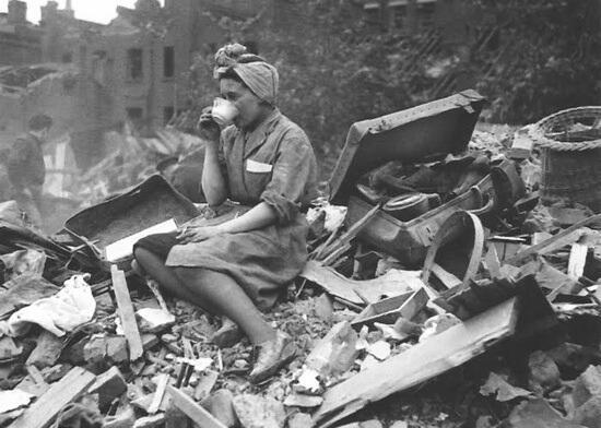 A woman drinking tea, 1940, in the aftermath of a German bombing raid during the London Blitz